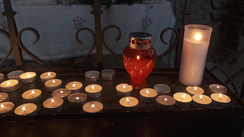Lights of faith, spiritual candle burn in rows, religiuos symbolism Live Action