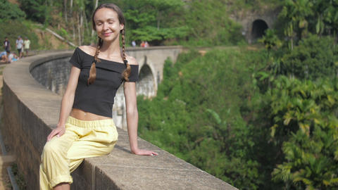 girl spends vacation sitting on popular bridge in jungle Live Action