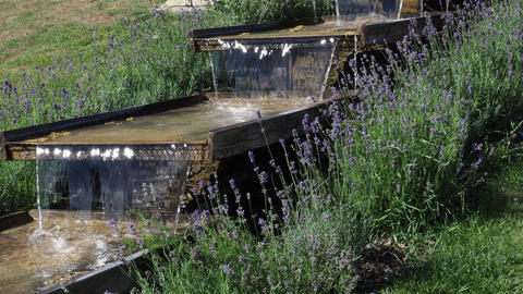 Wooden irrigation water channel. System of water cascade made of wooden gutters mounted on wooden Live Action