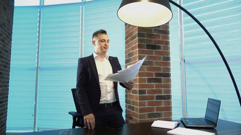 Angry Businessman Throwing Papers In Office Live Action