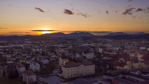Aerial hyper-lapse of sunsest above a small historic town in Europe, tranquil Live Action