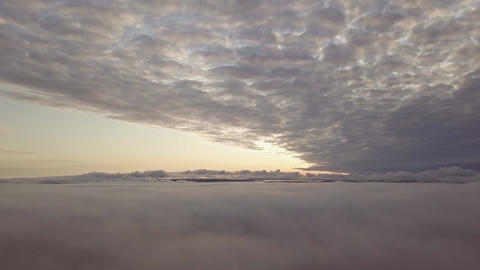 Slowly panning aerial view between layers of fog and clouds Live Action