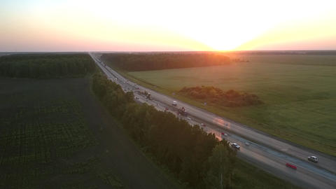 highway renewal among wide fields in evening aerial view Live Action