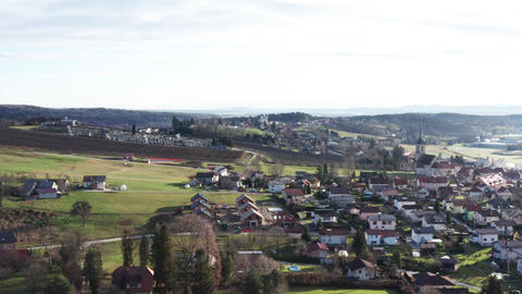Suburban residential area with residential houses, church and graveyard on Live Action