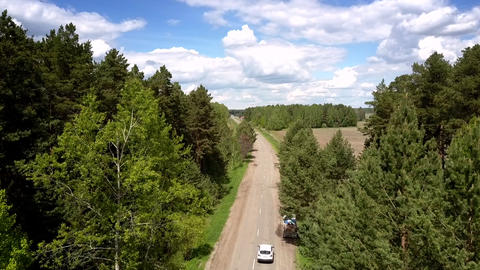sport utility vehicle drives on gray road bird eye view Live Action