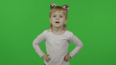 Girl in headband with a cat ears dancing. Happy four years old child. Chroma Live Action