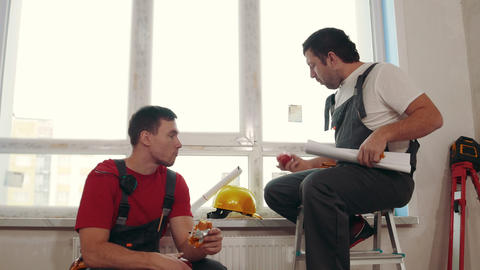 Apartment repair in draft apartment - men workers sitting on the windowsill and Live Action