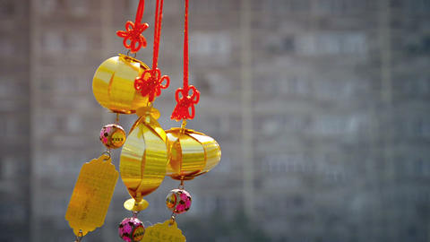 Gold-Colored. Asian Lantern-Style Ornaments Blowing in the Breeze Footage