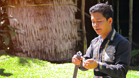 Professional tour guide explains the use of traditional. native hunting instrume Footage