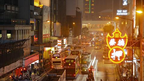 Bright neon signs and sodium vapor street lamps provide plenty of light on a maj Footage