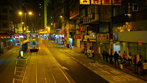 Riding a trolley along a downtown. urban street in Hong Kong. China at night Footage
