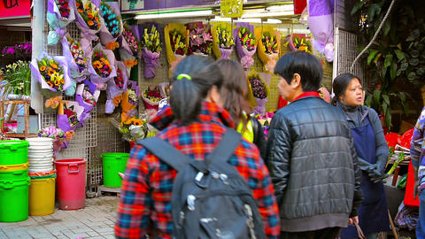 Small floral shop in downtown Hong Kong selling brightly colored bouquets of bea Footage