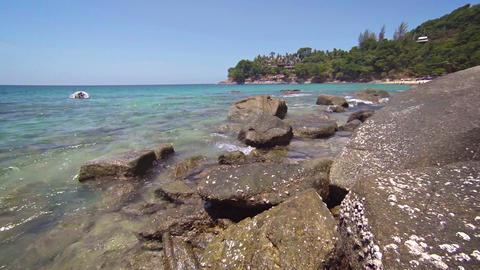 Rubber Dinghy Anchored off a Rocky Tropical Beach Footage