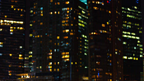 Commercial Highrise Buildings at Night in Selective Focus Footage