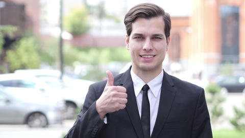 Thumbs Up by Happy Businessman, Outdoor Close Up Live Action