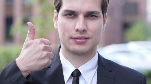 Thumbs Up by Businessman, Portrait, Outdoor Close Up Live Action