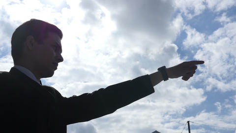 Silhouette of Businessman Showing Direction, Leader Pointing with Finger Live Action