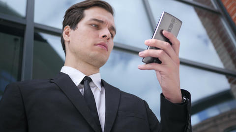 Young Businessman Using Smartphone, Text Messaging Footage