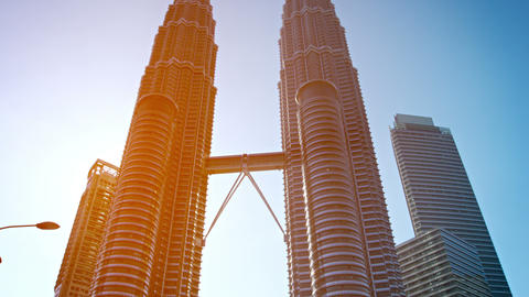 Petronas Twin Towers dominate the skyline over the afternoon commuter traffic in Footage