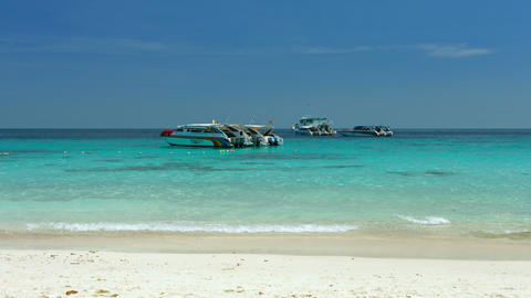Colorful tour boats at anchor. just of Koh Similan. the largest of Thailand's pr Footage
