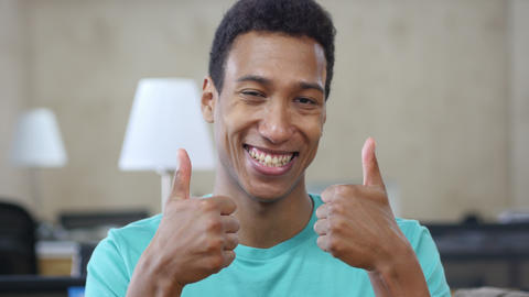 Thumbs Up by Young Black Man with Both Hands, Portrait Live Action