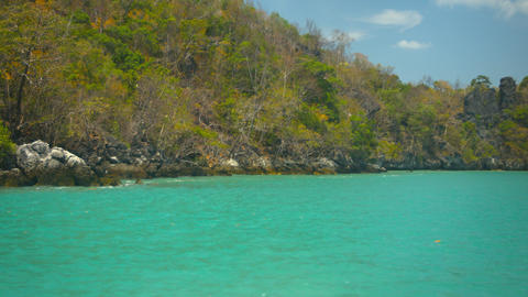 Cruising by a Rocky. Tropical Island Beach in Timelapse Footage