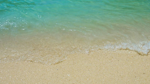 Gentle Waves Washing over a Tropical Sandy Beach Footage