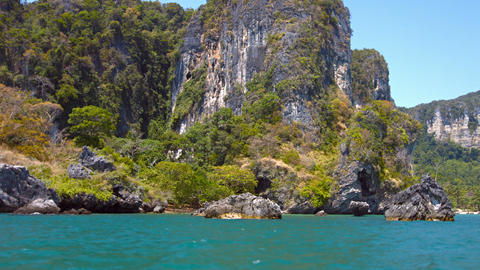 Limestone Cliffs Towering over a Rocky Tropical Beach Footage