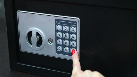 opens safe deposit box Live Action