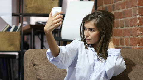 Sitting Beautiful Lovely Girl Taking Selfie with Smartphone Footage