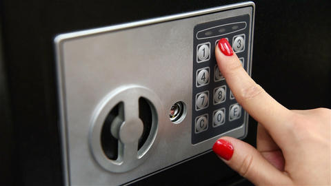 women hand opened electronic bank safe Live Action