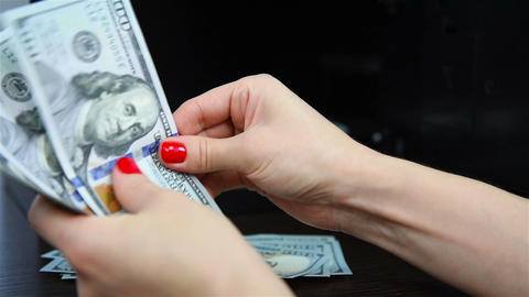 Woman's hands counting money Footage