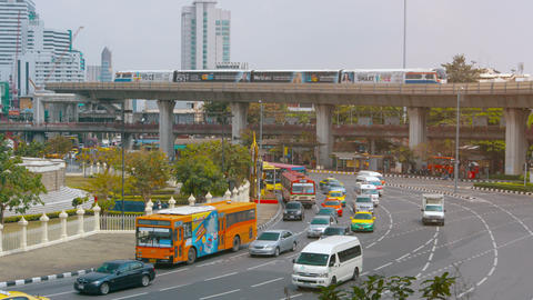 Typical urban traffic at a massive roundabout in downtown Bangkok. with an eleva Footage