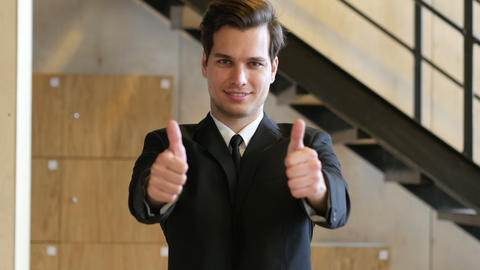 Thumbs Up with Both Hands by Businessman Footage