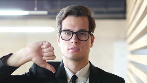Thumbs Down Gesture by Man in Suit, Portrait Footage