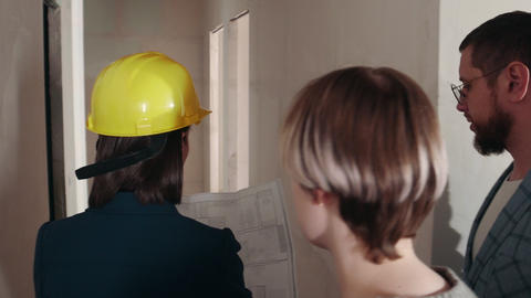 Apartment renting - A young woman real estate agent showing apartment to a young Live Action