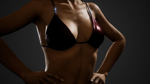 Fitness athletic woman in bikini posing Live Action