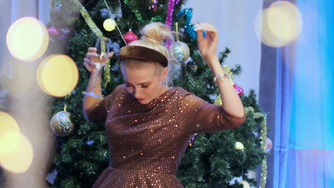 Beautiful lady dancing near the Christmas tree Live Action