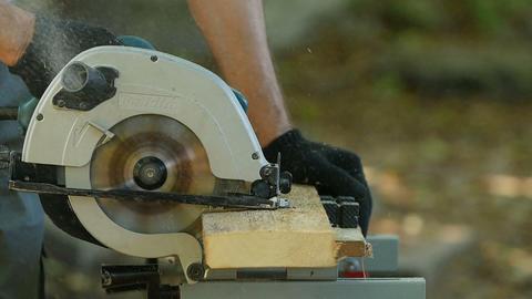 carpenter with a circular saw Live Action