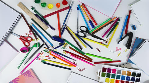Animation of stationery on the desktop of an designer, logo intro looped stop Live Action
