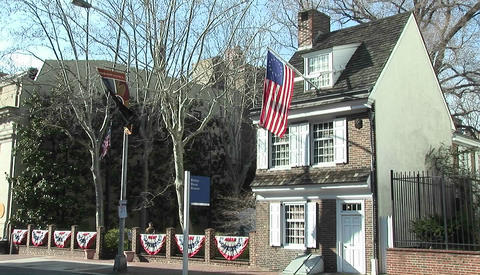 The Betsy Ross house in Philadelphia with American flag flying Footage