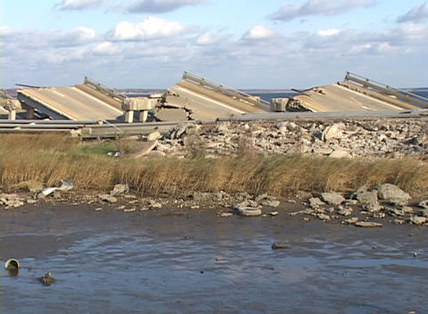 Medium shot of the rubble from a bridge damaged during Hurricane Katrina Footage