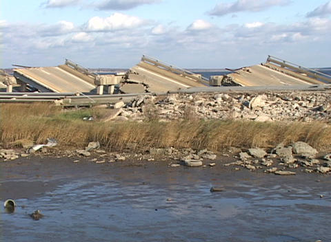 Medium shot of the rubble from a bridge damaged during... Stock Video Footage