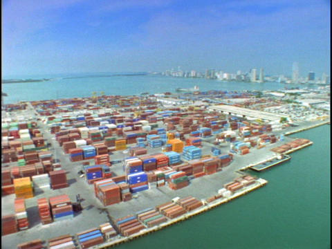 Cargo containers fill a dock in this aerial shot over the Port of Miami Footage