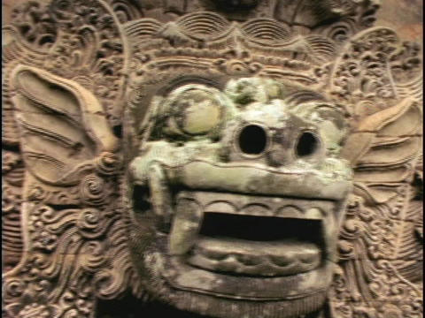 A Balinese stone carving of a Hindu image adorns a wall in Bali, Indonesia Footage