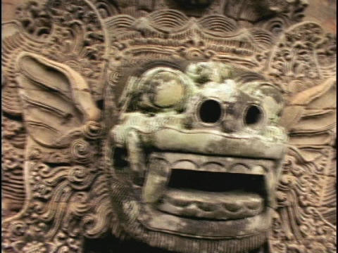 A Balinese stone carving of a Hindu image adorns a wall... Stock Video Footage