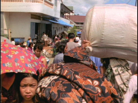 Patrons crowd a market in Indonesia Stock Video Footage
