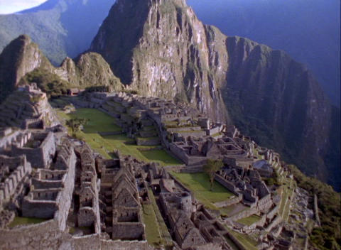 Aerial pan across Inca ruins of Machu Picchu, Andes... Stock Video Footage