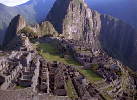 Aerial pan across Inca ruins of Machu Picchu, Andes Mountains, Peru Footage