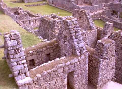 Pan across Inca ruins of Machu Picchu in Peru Stock Video Footage
